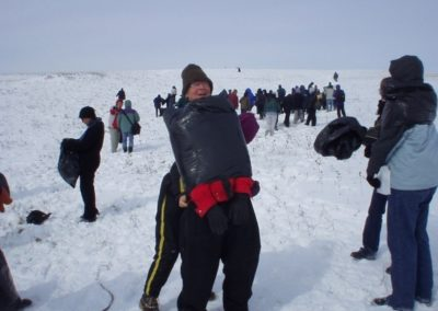 """Dressing in Garbage bags, Ray Arnatt participates at Eco-Art Happening, <i>""""What is Our Human Mark on the Earth?"""", Nose Hill Park, Calgary, Alberta, Canada, 2002<p><p>""""I want to be a Canadian Garbage!""""  Why?  """"I would get a free cruise around the world and end up back in Vancouver!"""", stated by Jaroslav Skvaril on June 29th, 2019 after the container scandal.  https://www.cbc.ca/news/canada/british-columbia/garbage-containers-return-1.5195007"""