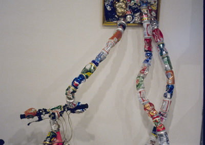 """DETAIL:  <i>""""ReCycle""""</i> from <i>Transforming Matters</i>, Found objects, cans; Solo show, The Little Gallery, Faculty of Fine Arts, University of Calgary, Alberta, Canada, 2002"""
