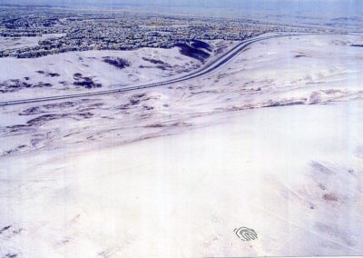 """Aerial photo from helicopter of formation of human fingerprint, Nose hill Park, for Art Happening/ Environmental Event: <i>""""What Is Our Human Mark on the Earth?""""</i>, Calgary, Alberta, Canada, 2002"""