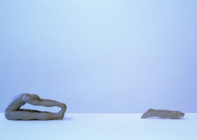 "<i>Paschimothanasana, Forward bend with negative space</i>, clay, 8"" x 3"" x 5"", 2005"