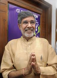 "Kailash Satyarti's words, ""Let us democratize justice, let us universalize knowledge.  Together, let us globalize compassion.""<p><p>""Kailash Satyarthi is an Indian children's rights activist. He is a Nobel Peace Prize recipient and founder of Bachpan Bachao Andolan, Global March Against Child Labour, Global Campaign for Education, Kailash Satyarthi Children's Foundation, and Rugmark now known as GoodWeave International."" Wikipedia<p><p>The Canadian Labour Congress commissioned a carpet painting from me to give to Mr. Satyarthi.  <p><p>86th session of the International Labour Organization Conference, in the United Nations Assembly Hall, Geneva, Switzerland.  Two carpet paintings on exhibit:  <i>Iqbal Masih</i> and <i>A Step in the Global March</i>, where the second work was presented as a gift from the Canadian Government, to Kailash Sathyarti, creator of the Global March Against Child Labour.  https://www.ilo.org/global/about-the-ilo/newsroom/news/WCMS_007984/lang--en/index.htm"