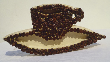 "<i>Flat Object</i>, 1997, coffee beans and wood, 7"" x 6"""