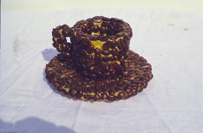 "<i>Object for a chat break</i>, coffee beans and espresso cup from the Cafe de Flore, Paris, 1997, 2 1/2"" in diameter, 4"" in diameter x 3""tall, Topic for chat: ""I think it is the duty of a woman to lead a life that expresses her disbelief in the validity of the taboos that have been imposed upon her kind for thousands of years. Nobody will give you freedom; you have to take it."" Meret Oppenheim , *Nelson Landsdale and St. Clair McKelway, Talk of the Town, ""Critical Note,"" The New Yorker, December 26, 1936, p. 7."